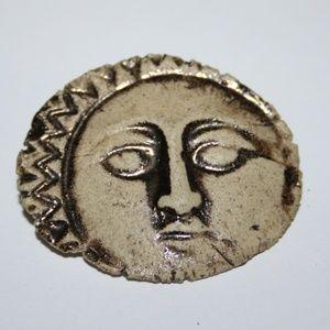 Beautiful vintage carved sun brooch